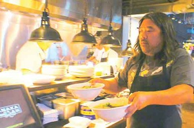 "Executive chef Eric Tanaka (""ET"") works the kitchen at TanakaSan on opening night. Photo by Ronald Holden"