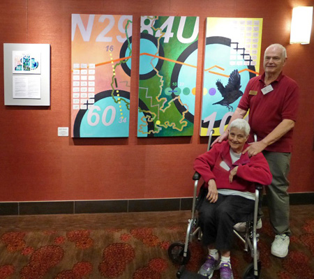 Marilyn and Dick Fike stand in front of the artwork they inspired, painted by Don Haggerty. Photo courtesy of June Sekiguchi