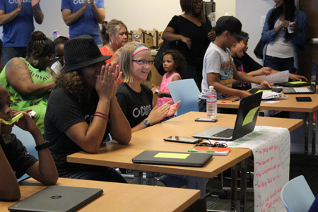 Campers in the C1 Coders Camp find out they will be allowed to keep the Chromebook laptops they used to design and build apps during the week. | Photo by Daniel Nash